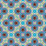 Colorful blue , red and green floral symmetrical repeating pattern stock illustration
