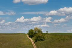 Colorful blue skies above the hill and country road stock photos