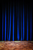 Colorful blue stage curtains and tiled floor Stock Photo
