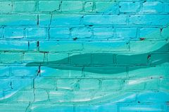 Colorful blue and turquoise painted brick wall royalty free stock images