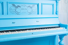 Colorful blue upright piano Royalty Free Stock Images