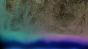 Colorful blue and violet ink mixing in water, swirling softly underwater on black background with copy space stock video footage