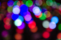 Colorful blur bokeh fairy street light festival, night defocused & dark background. Abstract colorful blur bokeh fairy light festival, city street light royalty free stock photography