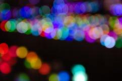 Colorful blur bokeh fairy street light festival, night defocused & dark background. Abstract colorful blur bokeh fairy light festival, city street light stock image