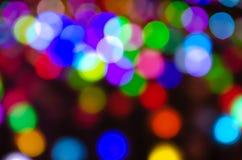 Colorful blur bokeh fairy street light festival, night defocused & dark background. Abstract colorful blur bokeh fairy light festival, city street light stock photography