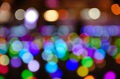 Colorful blur bokeh fairy street light festival, night defocused & dark background. Abstract colorful blur bokeh fairy light festival, city street light royalty free stock photo