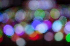 Colorful blur bokeh fairy street light festival, night defocused & dark background. Abstract colorful blur bokeh fairy light festival, city street light stock images