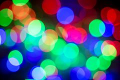 Abstract colourful bokeh background. Colorful blur vivid toned bokeh background royalty free stock image