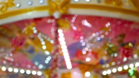 Colorful blured merry background with defocused pink carousel and lights. Colorful blured merry background with defocused pink swirling carousel and lights stock footage