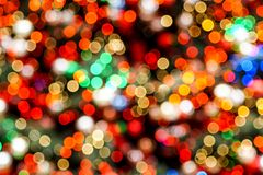 Colorful blurred christmas lights glittering stock photography