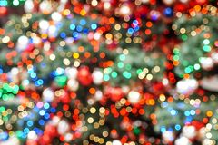 Colorful blurred christmas lights glittering royalty free stock photography