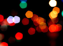 Colorful blurred lights. An abstract background of lights of various colors blurred and out of focus with a black background Stock Photography