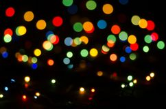 Colorful blurred lights on a black background. Bokeh, soft focus stock images