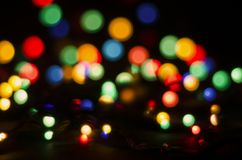 Colorful blurred lights on a dark background. Bokeh, soft focus stock image