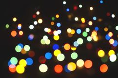Colorful blurred lights on a dark background. Bokeh, soft focus stock photography