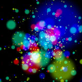 Colorful blurry dotted lights over black Stock Images