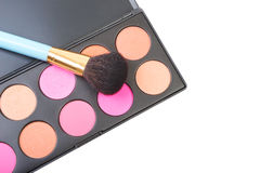 Colorful blush for cheeks palette with professional makeup brush Stock Images