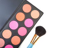 Colorful blush for cheeks palette with professional makeup brush Royalty Free Stock Photos