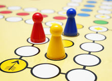 Colorful Board Game. Close-up of a board game with colorful pieces - competition concept Stock Photos