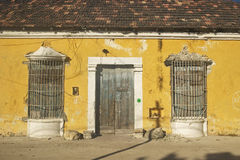 Colorful boarded up yellow house in Celestun, Mexico in Yucatan Peninsula, Mexico Stock Images