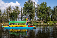 Colorful boat also known as trajinera at Xochimilcos Floating Gardens - Mexico City, Mexico Stock Image