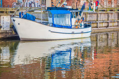 Colorful boat. Fishing boat moored in canal Royalty Free Stock Photography