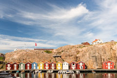 Colorful boat houses at Smogen, Sweden. Typical genuine Swedish west coastal environment in Bohuslan with boathouses, bridges and happy summer guests walking stock photos