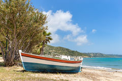 Colorful boat lying on greek beach Stock Image