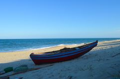Colorful Boat at Macaneta beach in Maputo Mozambique. Blue and red color Royalty Free Stock Photo