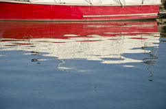 Colorful boat reflections on sea water Royalty Free Stock Photos