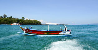 A colorful boat on the sea in Bali, Indonesia Stock Images