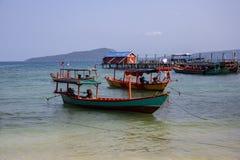 Colorful boat on seashore. Traditional wooden boats. Koh Rong island harbor landscape. Cambodia travel photo. stock photos