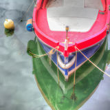 Colorful boat by the shore in Temo river Royalty Free Stock Images