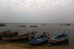 Colorful Boat. Wooden boat in Ubein Bridge at sunrise, Mandalay, Myanmar royalty free stock photography