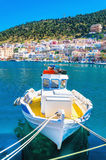 Colorful boat with yellow deck moored in Greek bay Stock Photography