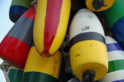 Colorful boating buoys bunched. Brightly colored boating buoys bunched and hanging royalty free stock photos