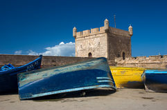 Colorful boats. Colorful fishing boats with stone walls and battlement from port in Essaouira, Morocco, Africa Stock Images