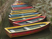 Colorful Boats. Colorful rowboats lined up in a canal Stock Photography