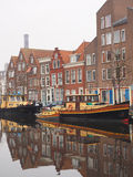 With colorful boats amidst residential housing Royalty Free Stock Photography