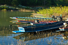 Colorful boats on the bank Stock Photos