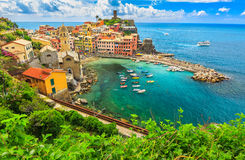 Colorful boats in the bay,Vernazza,Cinque Terre,Italy,Europe. Stunning panorama of Vernazza and suspended garden,Cinque Terre National Park,Liguria,Italy,Europe Royalty Free Stock Photo