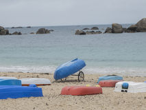 Colorful boats on the beach. Cliff in the background Stock Photography
