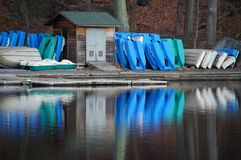 Colorful boats. Blue and green boats reflecting in the water Royalty Free Stock Images