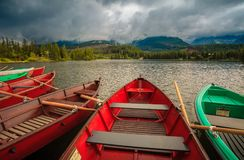 Colorful boats on the dock surrounded mountains Stock Photography