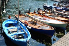Colorful small boats and ducks in touristic port of Sulzano, Italy. Colorful boats and ducks in touristic port of Sulzano, Italy Royalty Free Stock Images