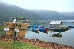 Colorful boats on Fewa lake(Nepal). royalty free stock photo