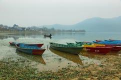 Colorful boats at Fewa lake in Pokhara Royalty Free Stock Photos