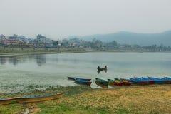 Colorful boats at Fewa lake in Pokhara Stock Photos