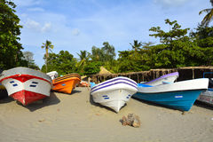 Colorful boats in fishermen village, Nicaragua. Small fisherman village on the Pasific ocean coast in Nicaragua Royalty Free Stock Image