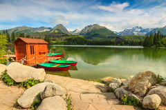 Colorful boats and hut on the lake,Strbske Pleso,Slovakia,Europe Royalty Free Stock Image